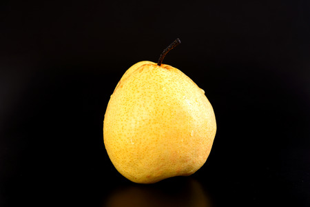 Fresh oriental pear on black background Stock Photo