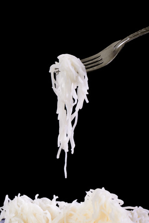 rice noodles on black background