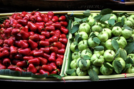 merah: The morning sun shine on the juicy fruits, trying to catch attention from whoever visiting Bangkok Floating Market on May 2008