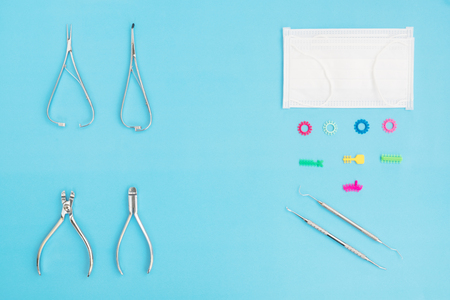 Orthodontic appliance tools set in the clinic for dentist to work; flat lay; top vipw.