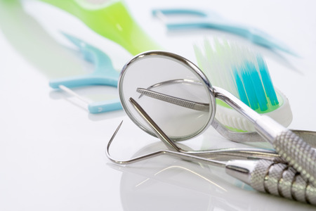 Close up  dental tools use for dentist on the white background.
