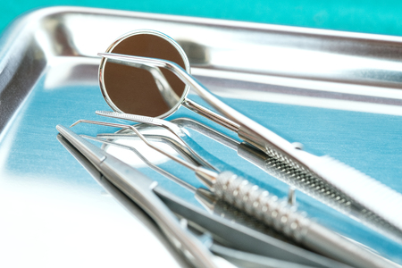 Close up, Professional tools of dentist on stainless steel tray.