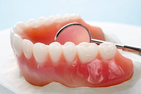 Close up , Complete denture or full denture on blue background. Stock Photo