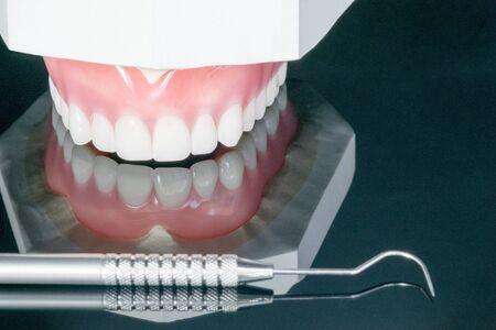 Close up , Complete denture or full denture on black background.