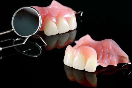 Closeup / Implant Prosthodontics or Prosthetic / Tooth crown and bridge implant dentistry equipment and model express fix restoration. 版權商用圖片