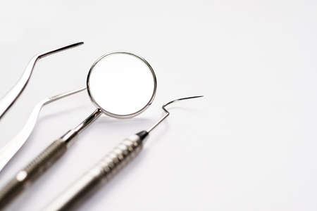 Dentistry medical tools syring on blue background.