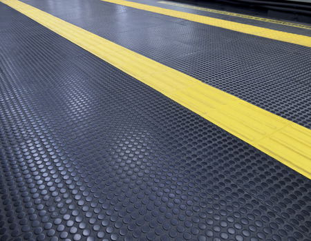 visually: platform floor accessibility - subway station - yellow guidance tracks - visually impaired Stock Photo