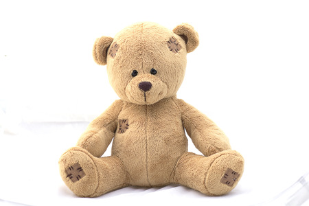 Brown teddy bear on white background.