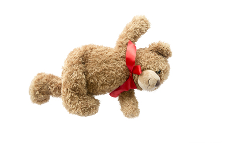 Teddy Bear with red ribbon bow In the upright and open arms,Isolated on white background. Stock Photo