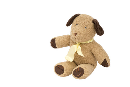Brown dog doll Yellow ribbon tie Sitting isolated on a white background