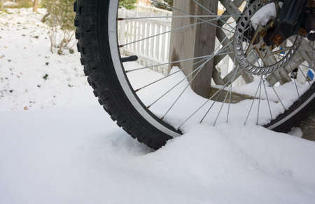 space weather tire: bicycle tire on snow Stock Photo