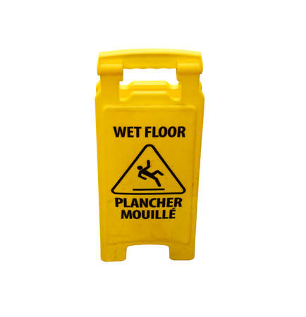 Yellow caution slippery wet floor sign labeled in English and French on white background with clipping path