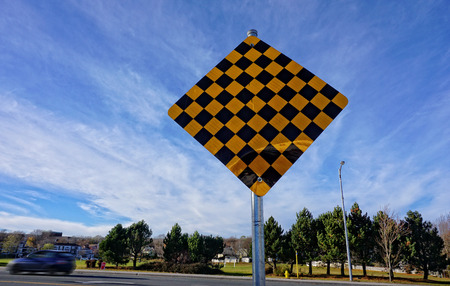 Checkerboard Traffic Symbol, alert motorists to the end of the road or a possible sharp turn ahead.