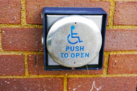 wheelchair access: handicap push button door opener,in front of mall Stock Photo