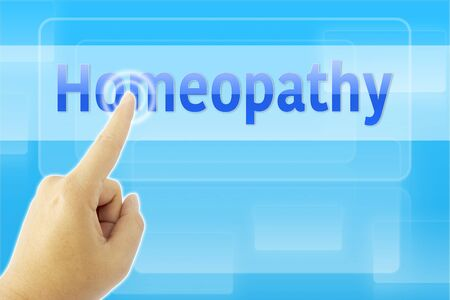 homeopathy: touching Homeopathy sign on blue screen