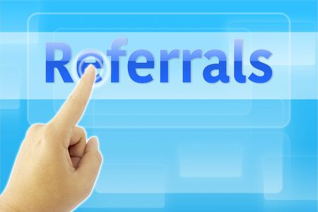 referrals: touching Referrals sign on blue screen