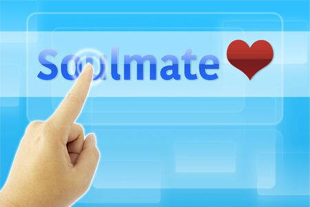 soulmate: touching SOULMATE sign on blue screen