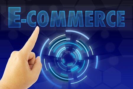 technology transaction: hand pointing E-commerce word on blue screen