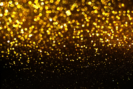 black and gold glitter bokeh texture abstract background