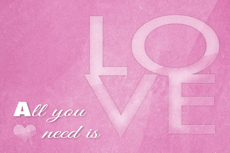 all you need is love on old grunge pink paper background
