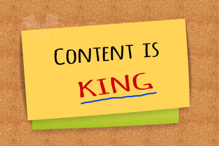 Content is king on sticky note Stock Photo