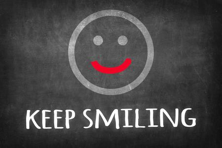 Keep smiling on Blackboard Stok Fotoğraf