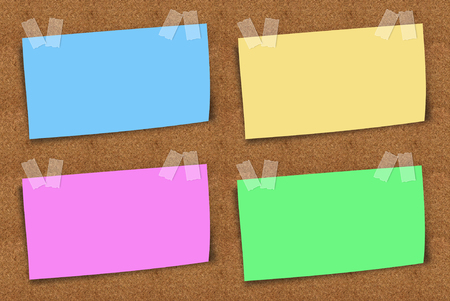 sticky notes: corckboard with four blank colorful sticky notes