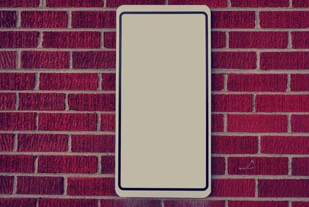 Red brick wall with blank sign