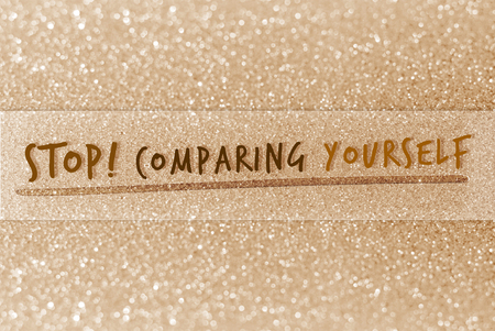 yourself: Stop comparing yourself on glitter abstract background