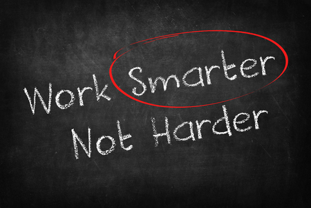 harder: work smarter not harder words on Blackboard Stock Photo