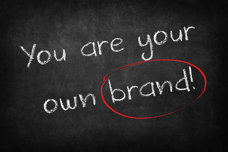 own: you are your own brand words on Blackboard Stock Photo