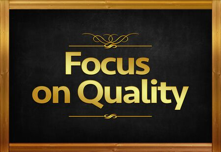 Focus on Quality word on blackboard
