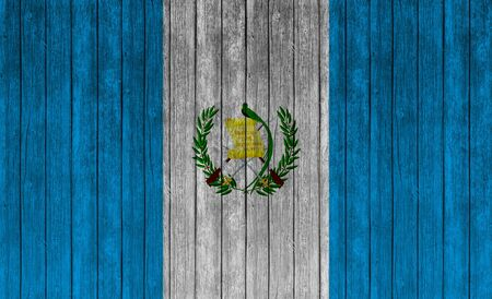 old flag: Flag of Guatemala on wood texture background