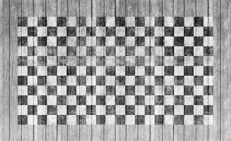 start to cross: Checkered finish flag on grungy wood plank background Stock Photo
