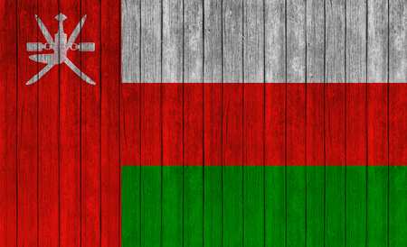oman background: Flag of Oman on wood texture background Stock Photo