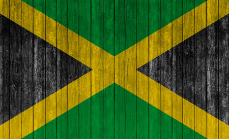 old flag: Flag of Jamaica on wood texture background