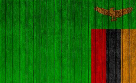 zambia flag: Zambia flag on wood texture background