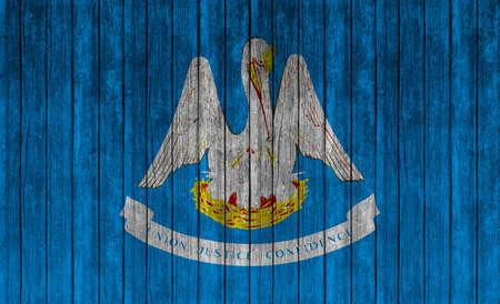 louisiana flag: Flag of Louisiana on wooden texture background Stock Photo