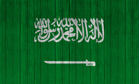 arabia: Saudi Arabia flag on wood texture background Stock Photo