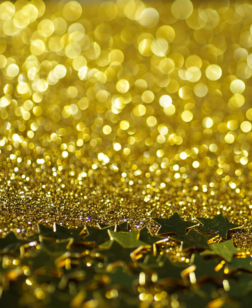 golden light: gold stars glitter abstract twinkled bright background Stock Photo