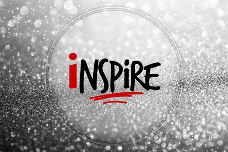 inspire word on glitter abstract background