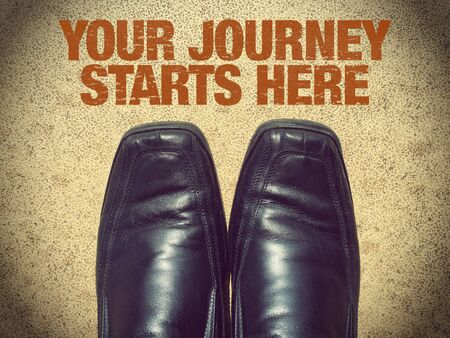 Black men shoes shoes with words Your Journey Starts Here Archivio Fotografico