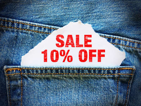 10% off on white paper in the pocket of blue denim jeans Stock fotó