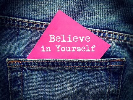yourself: Believe in yourself word on jeans background