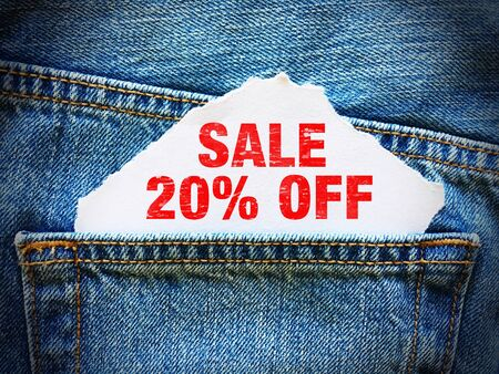 20% off on white paper in the pocket of blue denim jeans