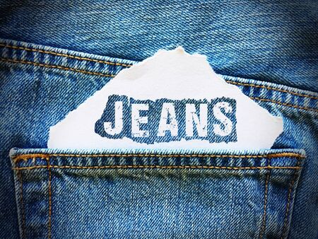 denim jeans: jeans word on white paper in the pocket of blue denim jeans