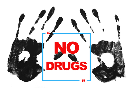warning against a white background: No drugs - International Day against Drug Abuse