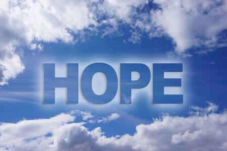 La speranza di parola sul cielo blu Archivio Fotografico