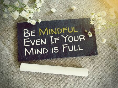 Blackboard for your text and flowers with words Be mindfull even if your mind is full