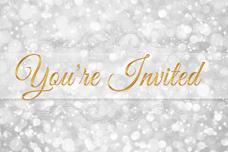 invited: youre invited word on white silver glitter bokeh abstract background